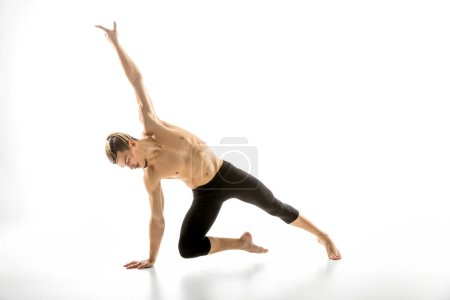 Photo for Young handsome shirtless man performing dance movemen isolated on white - Royalty Free Image