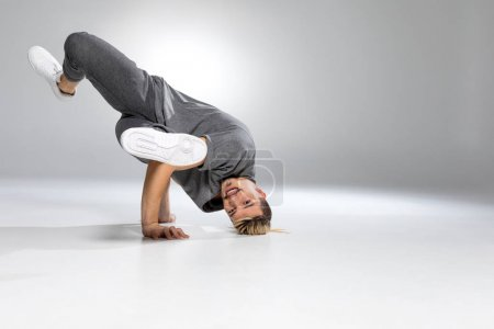 Young handsome breakdancer