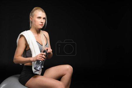 Sportswoman holding bottle