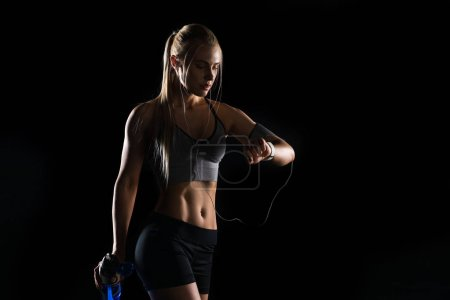 Sportswoman using smartwatch