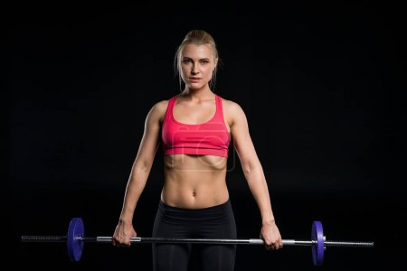 Woman exercising with barbell