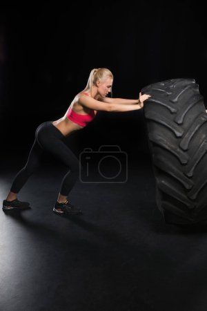 sporty woman with tire
