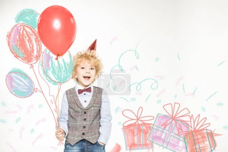 boy in cone hat with balloons