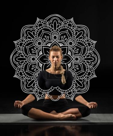 Young woman sitting and meditating