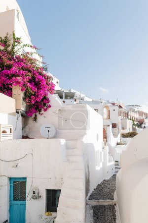 famous white buildings on street in Santorini