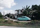 Cienfuegos, Cuba - January 9, 2017: retro cars parked near old houses