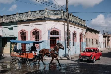 Santa Clara, Cuba - January 9, 2017: local people riding horse with cart on street