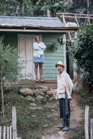 Granma, Cuba - January 20, 2017: couple standing next to small wooden house