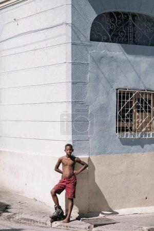 Santiago de Cuba, Cuba - January 20, 2017: boy standing in front of building on street