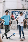 Havana, Cuba - January 22, 2017: local teenagers with skateboards in downtown