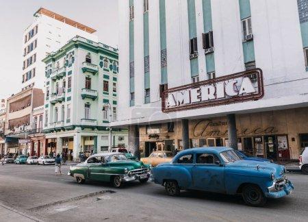 retro cars on road in city center