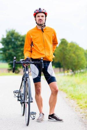 Cyclist with sport bike