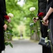 Family in guard of honor at funeral, only torso of...