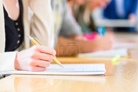 Photo for University college students writing test or exam - Royalty Free Image