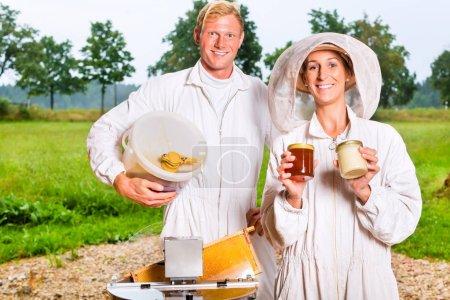 Beekeeper filling honey