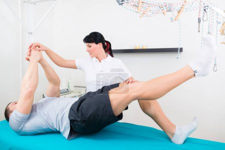Physiotherapist with patient in practice