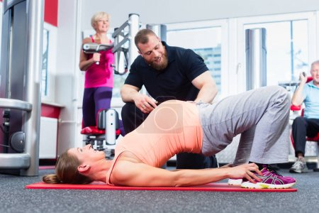 Pregnant woman working out with personal trainer