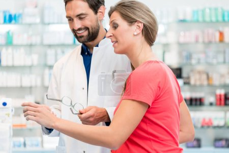 Women being helped by pharmacist to choose right remedy