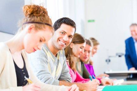 University college students having examination...