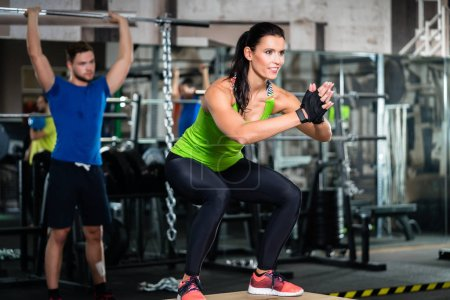 Group of men and woman in functional training gym