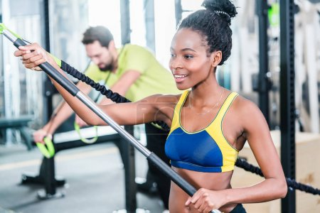 Woman and man in functional training for better fitness