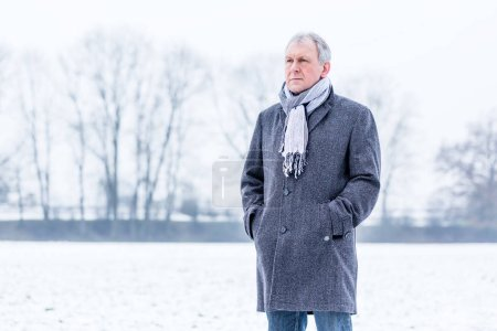 Photo for Depressed or sad man walking in winter - Royalty Free Image