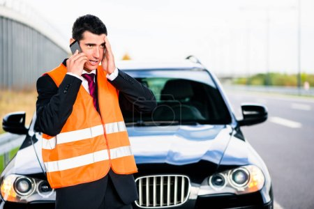 Photo for Man with car breakdown calling towing company - Royalty Free Image