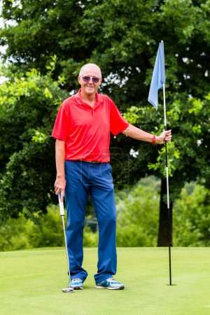 Senior man playing golf