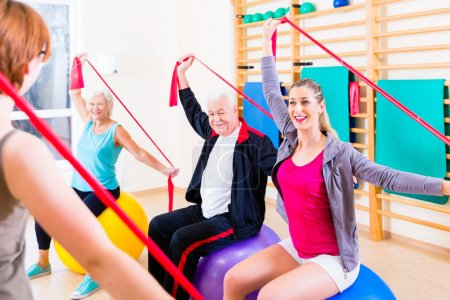 Senior people at fitness course in gym