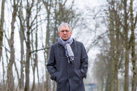 Photo for Depressed or sad man walking in winter - Royalty Free Image