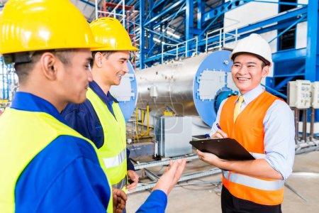 Asian factory worker and engineer as team