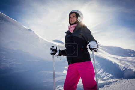 Woman skiing the mountains