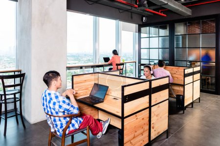 Start-up business people in coworking office