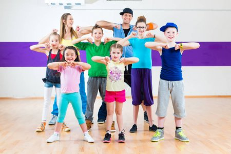 Dance teacher and kids in fitness class