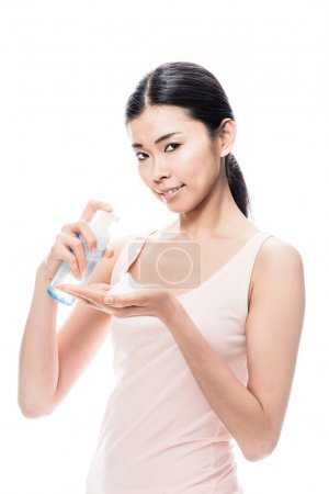 Young Asian woman pouring on hand cosmetic foam