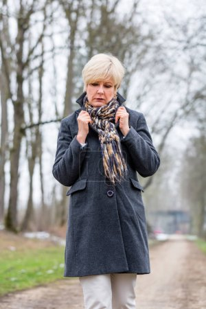 Photo for Depressed or sad woman walking in winter - Royalty Free Image