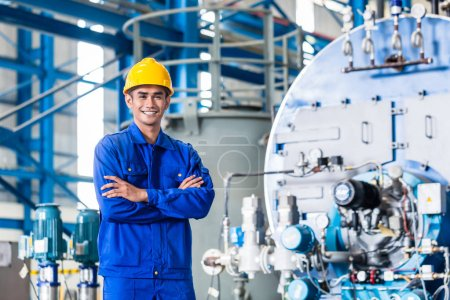 Proud Asian worker in production factory