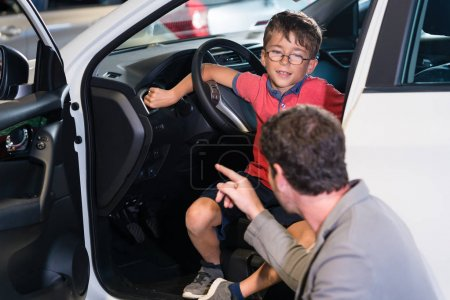 Father and son buying  car