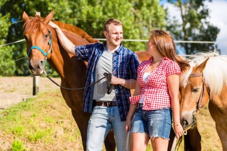 Couple petting horse