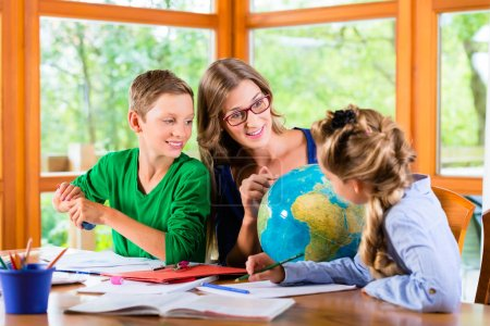 Mother teaching kids private lessons for school