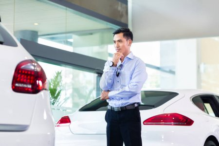 Asian man buying  car