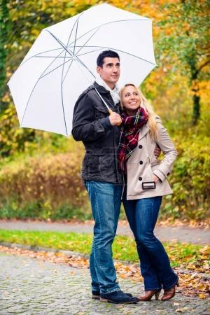 Couple enjoying fall day having walk