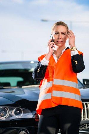 Woman with car breakdown