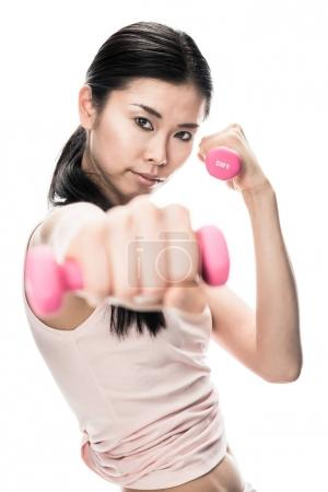 woman holding small dumbbells