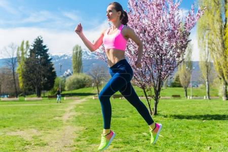 young woman running on meadow