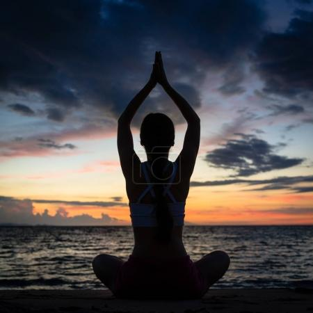 fitness young woman practicing yoga