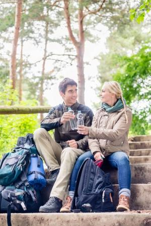 Backpackers hiking and taking rest in forest and d...