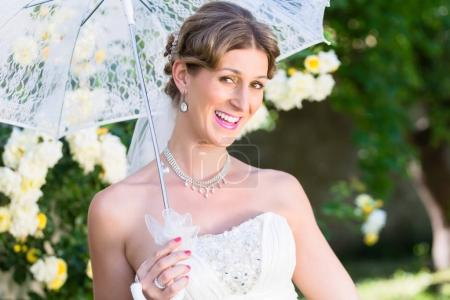Bride at wedding with parasol