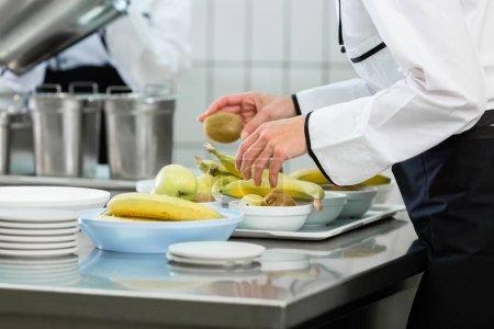 Chef preparing fruits