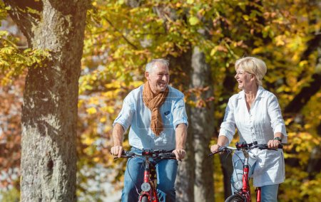 Senior couple riding on bicycles